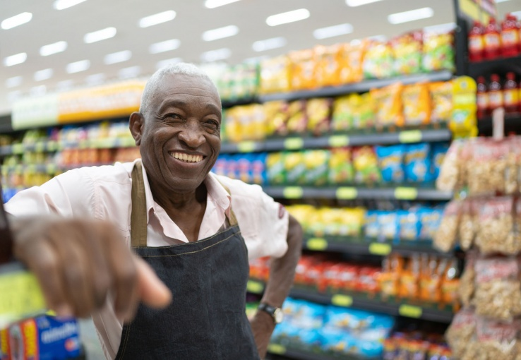 Smiling grocery store employee