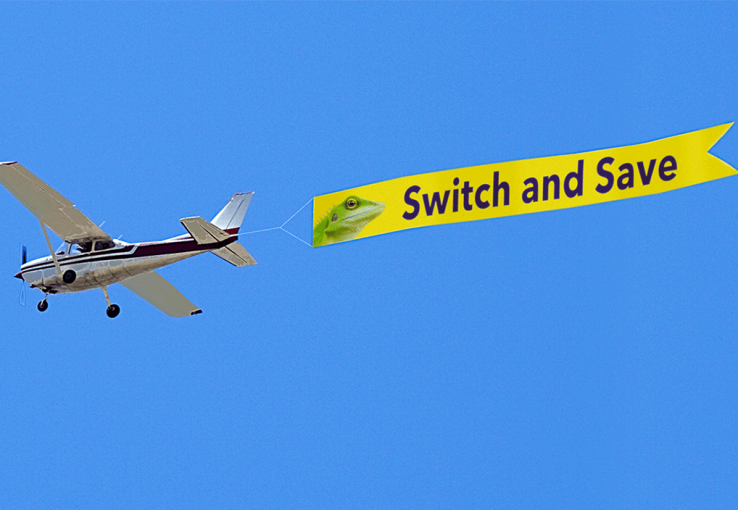 "Airplane with ""switch and save"" advertisement"